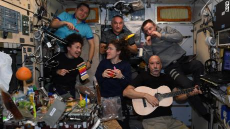The crew formed a band to sing mission control centers around the world.
